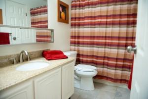 Bathroom with Marble Countertops and Tile Floor